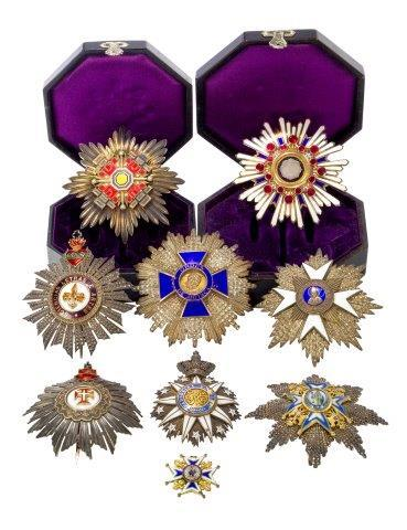 A breast star for the Order of St. James of the Sword, in silver and enamels, circa. 1900, 8.5cm high, together with a further collection of breast stars to comprise The order of Saint Sava, Serbia together with a badge
