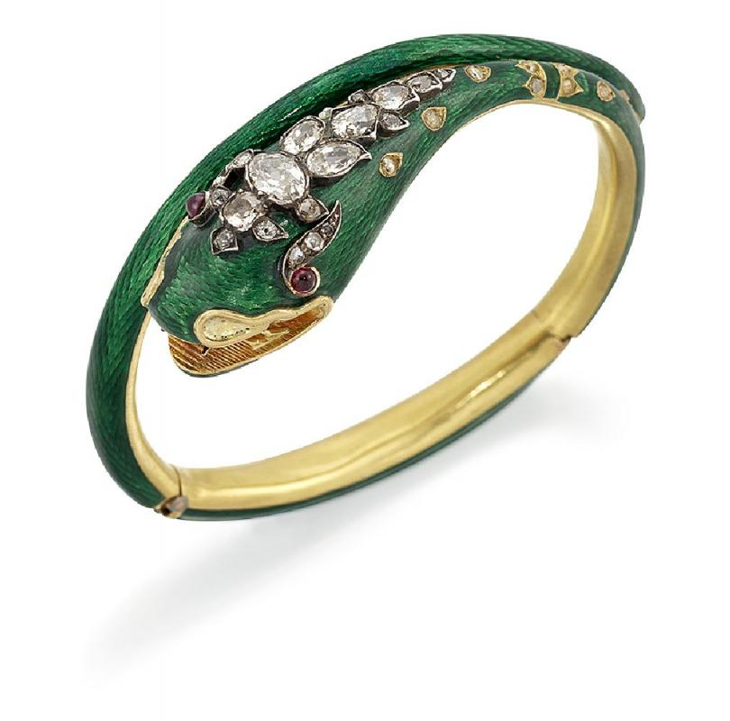 A Victorian gold, diamond and enamel serpent bangle, of green guilloche enamel