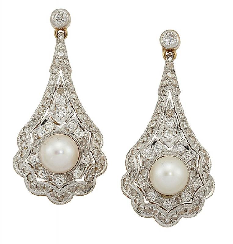 A pair of diamond and cultured pearl drop earrings, each with pear-shaped pierced panel drop