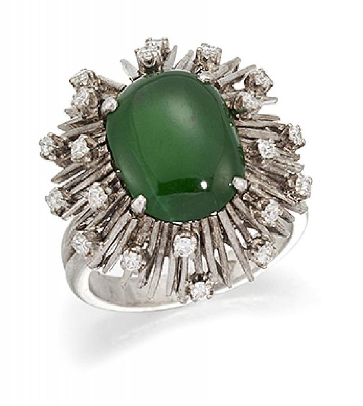 A jadeite jade and diamond ring, the central oval cabochon jade