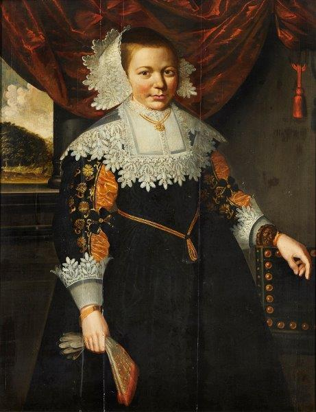 Circle of Cornelis de Vos, Flemish 1584-1651- Portrait of a young girl standing three-quarter length wearing a black dress with lace collar; oil on panel