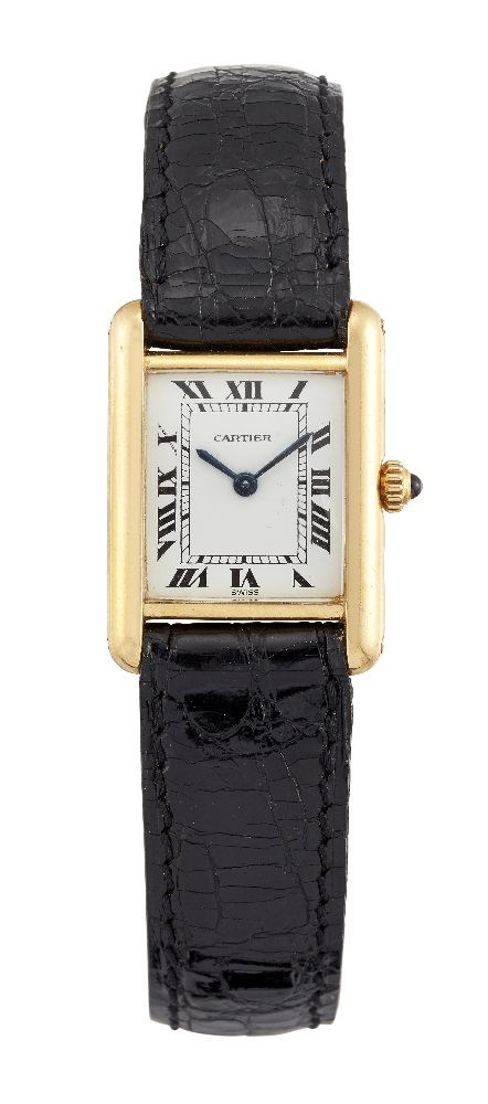 An 18ct gold 'Tank' quartz wristwatch by Cartier, the rectangular white dial with Roman numerals and secret signature at 10 o'clock
