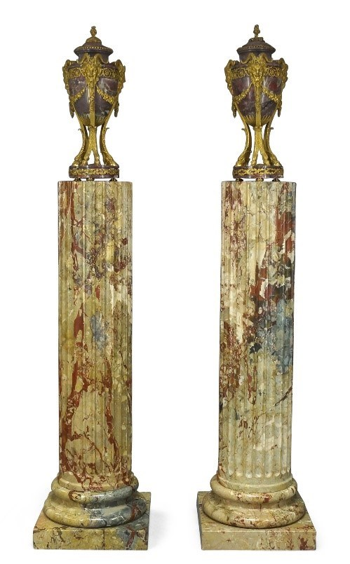 A pair of Louis XVI style gilt-bronze mounted breccia violette marble urns, 19th century