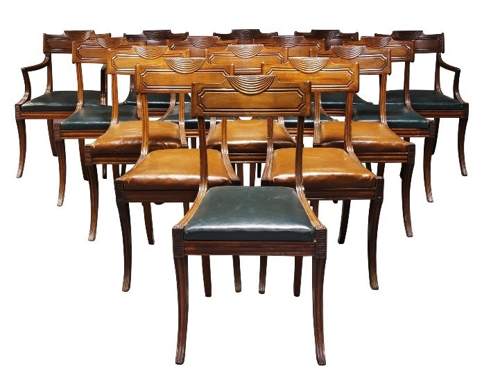 A set of sixteen Regency mahogany dining chairs