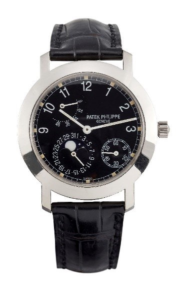An 18ct. white gold moon phases with power reserve automatic wristwatch by Patek Philippe Ref: 5055G