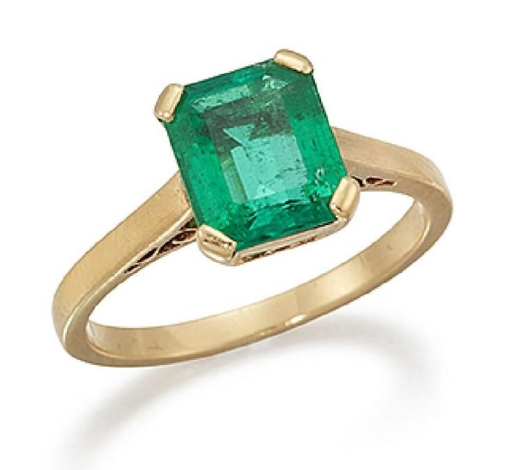 An emerald single stone ring, the rectangular-cut emerald, weighing approximately 1.70 carats, in four claw-set mount