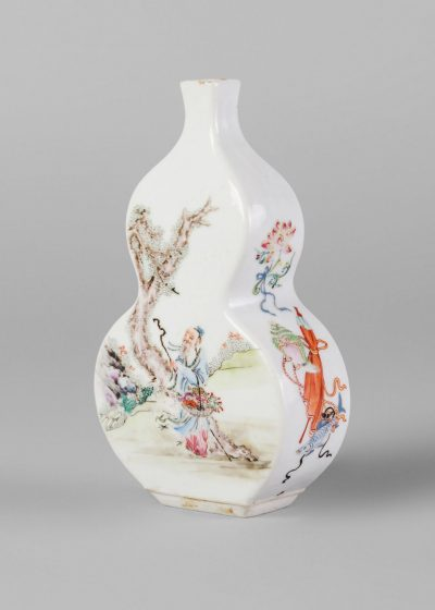 A rare Chinese porcelain double gourd-shaped vase, Qing dynasty, 18th century, finely painted in famille rose enamels with Cai Shen beside a boy holding a jar issuing wufu