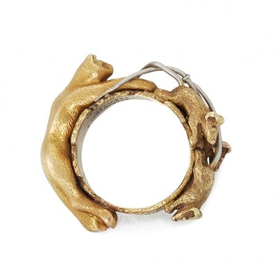 Lot 141 A novelty Tiffany & Co 'cat and mouse' ring in gold and platinum Sold £6800