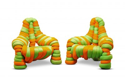 Anne Sutton and John Makepeace, a pair of orange and green upholstered lounge chairs, c.1974.