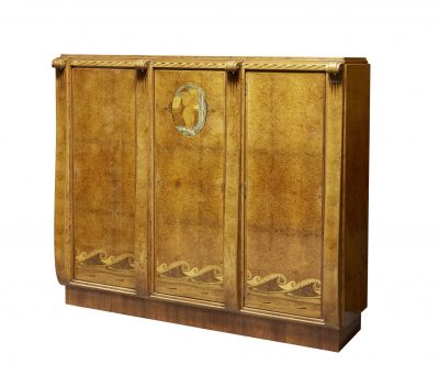 (Lot 151) an Art Deco burr walnut and marquetry bedroom suite attributed to by Paul Follot (1877-1941) is inlaid with mother-of-pearl, metal, ivory and other woods, c.1925