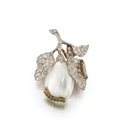 A late 19th early 20th century American, pearl, diamond and demantoid garnet pendant/ brooch, by Marcus & Co