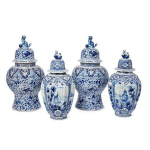 A pair of Dutch Delft octagonal vases and covers, 19th century, the lids with Chinese dog finials