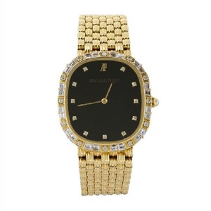 Description An 18ct gold and diamond quartz wristwatch by Audemars Piguet