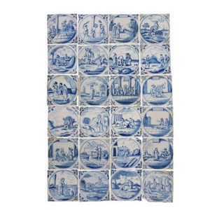A collection of twenty four Dutch blue and white tin glazed earthenware tiles decorated with scenes of religious subject matter and genre scenes, late 17th/18th century